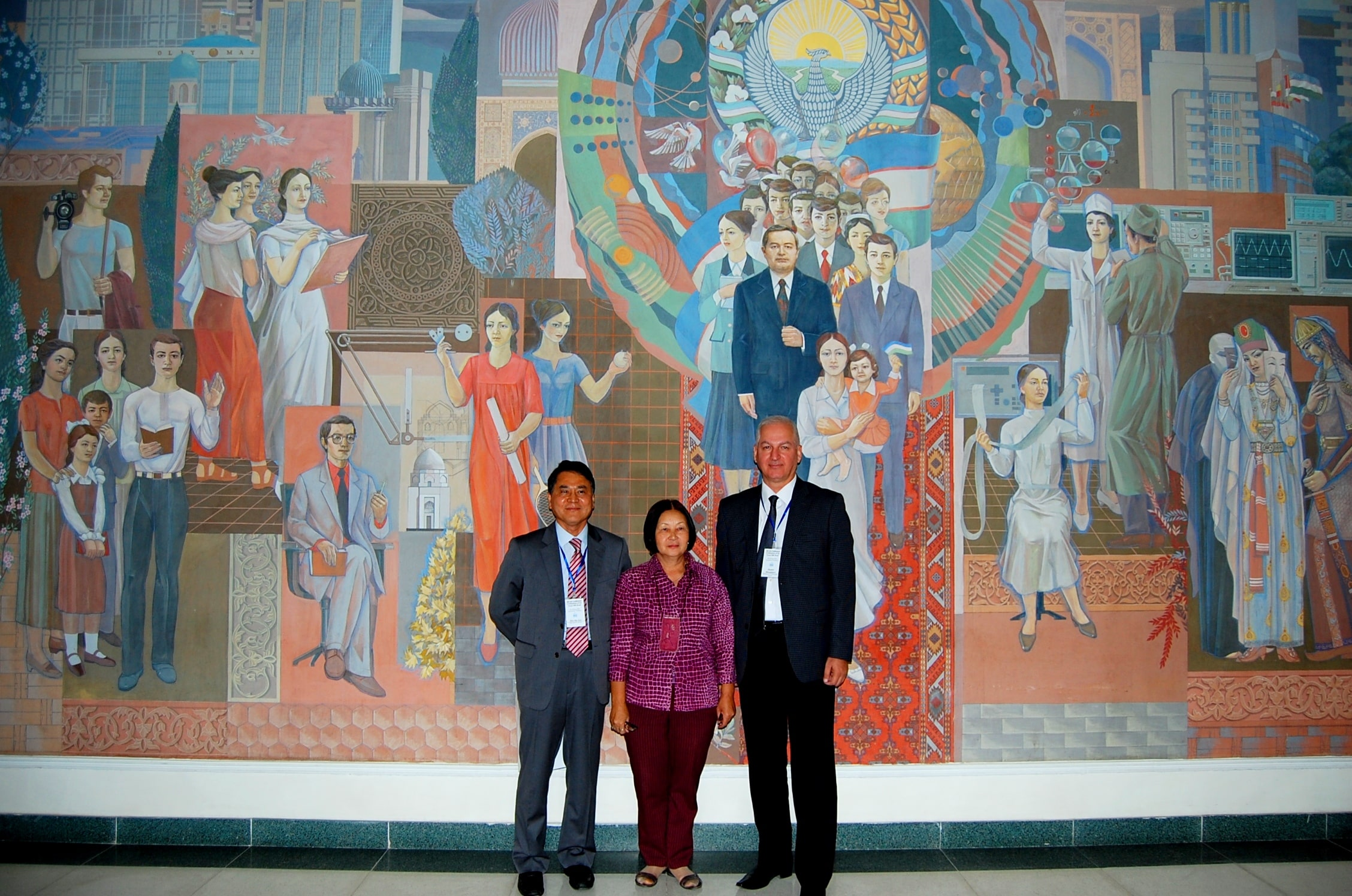 Members of the academic council on the background of a wall painting in Samarkand State University. Scientific Conference. Samarkand, September, 2017